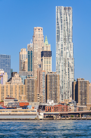 Skyscrapers in Lower Manhattan as seen from the Brooklyn Bridge Park, NYC, USA Stock Photo