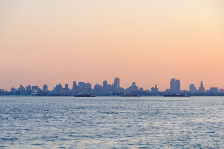 The colors of sunrise over Brooklyn as seen from the Staten Island ferry, New York, USA
