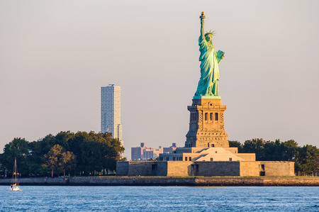 Statue of Liberty at sunrise from Staten Island Ferry, New York, USA
