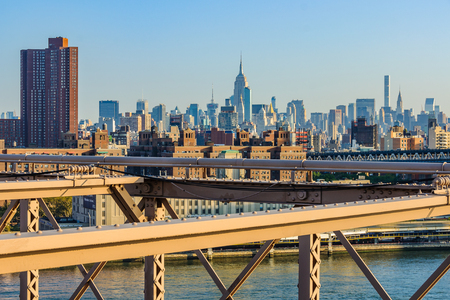 The NYC midtown skyline with the Empire State Building from the Brooklyn Bridge just after sunrise, New York, USA