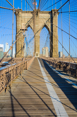 Almost nobody on the Brooklyn Bridge just after sunrise in New York, USA