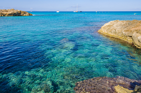 Transparent sea in Es Calo de Sant Agusti Cove in Formentera Island, Spain Stock Photo
