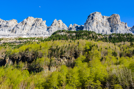 Moon over the mountain in Ordesa Valley in the Aragonese Pyrenees, Spain