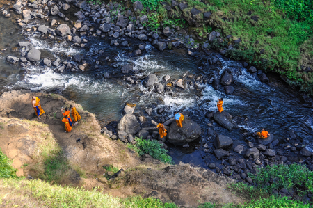 Buddhist monks in Tad Yuang Waterfalls in the Bolaven Plateau, Southern Laos