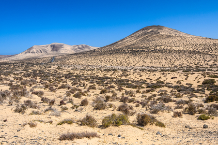 Colorful mountains near Sotavento Beach in Fuerteventura, Canary Islands, Spain Stock Photo