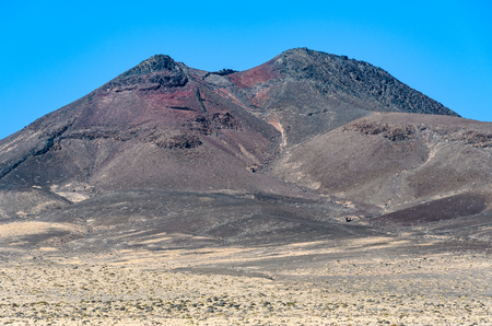 Red volcanic crater on Jandia Peninsula in Fuerteventura, Canary Islands, Spain