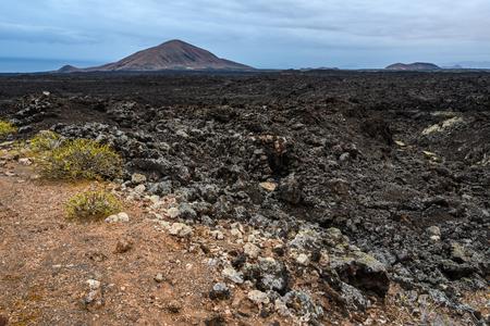 Volcanoes on the horizon in the volcanic Timanfaya National Park, Lanzarote, Spain