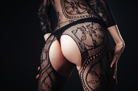girl boobs: Sexy beautiful naked woman in black erotic lingerie on a black background.
