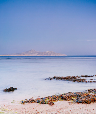 naama bay: Wonderful solar Red Sea beach at a luxury hotel, at sunset. Sharm El Sheikh, Sinai, Egypt. Gold sunset with mountains Stock Photo