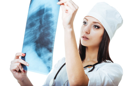 Female doctor looking at an x-ray,isolated on white background. photo