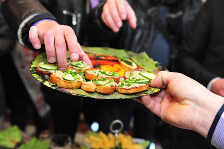 wedding reception: food preparation catering at the outdoor wedding. Serving tasteful food, catering.