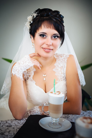 Bride in a cafe. sensual happy married couple in restaurant. summer holidays, love, travel, tourism, relationship and dating concept - romantic in the cafe photo