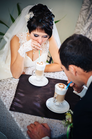 wed: Newly wed couple drinking cappuccino in cafe