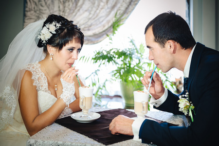 wed:  Newly wed couple drinking cappuccino in cafe Stock Photo