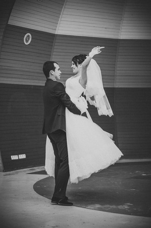 Bride and groom dancing in the park. Wedding dance in the open air. Dancers love flying. photo