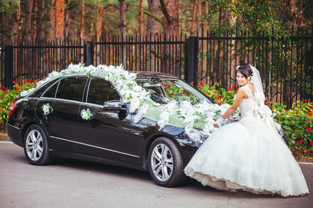 impassioned: The bride and groom kissing near a black car Stock Photo