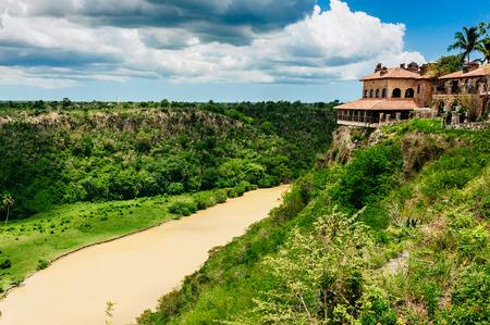 Tropical river Chavon in Dominican Republic. Vocation and travel. Ancient village Altos de Chavon - Colonial town reconstructed in Casa de Campo, La Romana, Dominican Republic