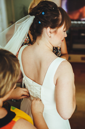 getting a bride: Bride getting ready. Bride dressing gown. bride is getting ready in the morning Stock Photo