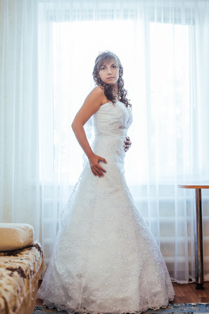 getting a bride: Beautiful caucasian bride getting ready for the wedding ceremony. Stock Photo