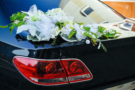 expensive car: Romantic Wedding Decoration Flower on Wedding Car in Black and White. Stock Photo