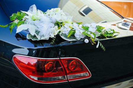 shiny car: Romantic Wedding Decoration Flower on Wedding Car in Black and White. Stock Photo