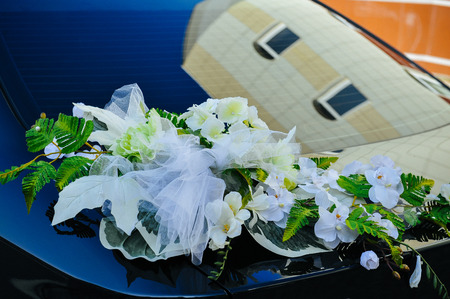 Romantic Wedding Decoration Flower on Wedding Car in Black and White. photo