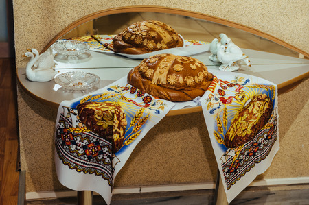 ukranian: traditional ukranian wedding loaf. Delicious wedding bread and salt are ready for guests. Stock Photo