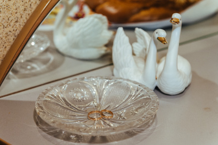 chased: two gold wedding rings on the decoration crystal plate