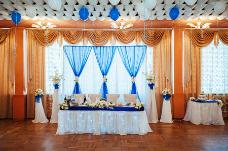 wedding table decor: Head table for the newlyweds at the wedding hall. Stock Photo