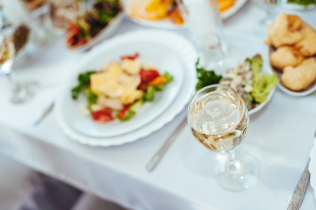 stemware: catering table set service with silverware and glass stemware at restaurant before party Stock Photo
