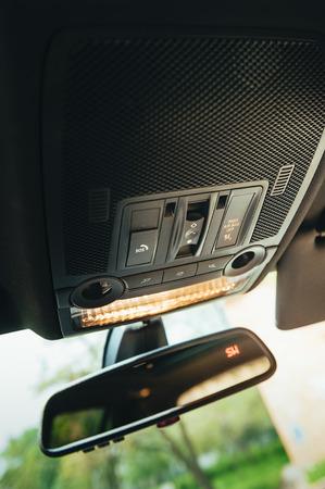 elite: reflection in black elite car mirror. automobile theme