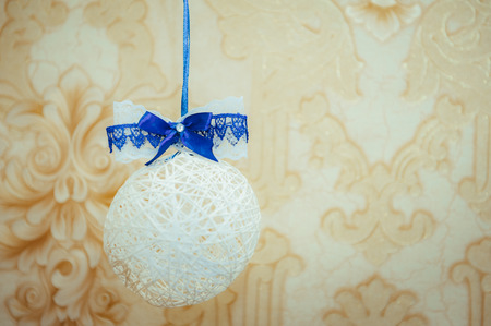 embellishments: ball of white thread festive decoration embellishments.