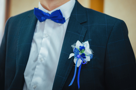 boutonniere: Grooms Boutonniere. Wedding boutonniere on suit jacket of groom Stock Photo