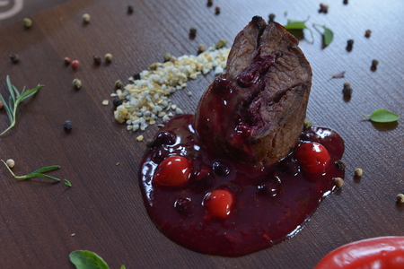 Exquisite food on a dark wooden wenge background. Gourmet Restaurant Food - Delicious Smoked meat, fish and Vegetable Salads. Luxury Appetizer Restaurant Food