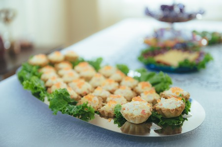 Delicacies and snacks at a buffet or Banquet. Catering. Stock Photo