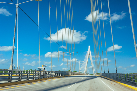 Wonderful white bridge structure over clear blue sky. Mauricio Baez Bridge, a cable-stayed bridge near San Pedro de Macoris, Dominican Republic, is one of the most modern and beautiful bridges in the Dominican Republic and the Caribbean.