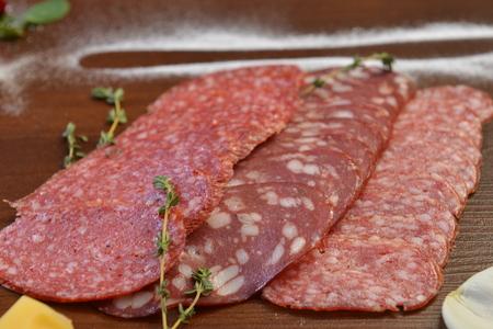 Three types of smoked sausages, Salami slices.