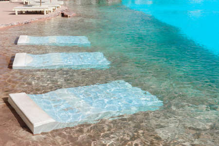 Swimming pool with beds for resting