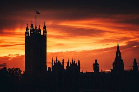 House of parliament in London, summer sunset sky in background.