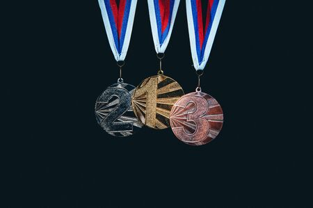 Gold silver and bronze medal on black background. 版權商用圖片