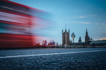 London. Classic red double decker bus crossing Westminster Bridge in front of House of parliament and Big Ben in London Stock Photo