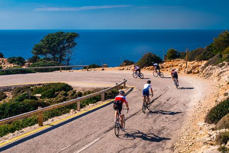 Athletes on road bicycle ride by the sea. Teamwork.., sport in beautiful nature.