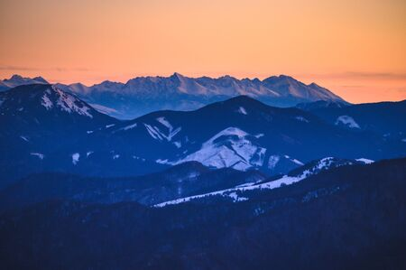 High Tatras panorama. Photo from Hill Krizna in slovakian mountains Velka Fatra. Sunrise light.