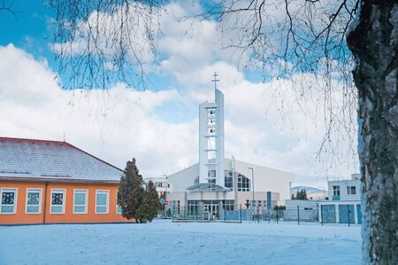 Church in winter city, Christianity photo, blue edit space. Banco de Imagens