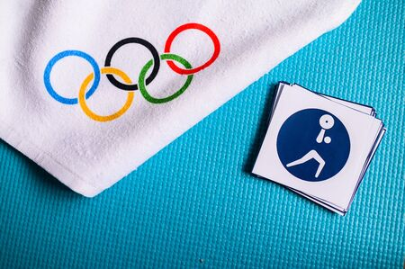 TOKYO, JAPAN, JANUARY. 20. 2020: Weightlifting pictogram and olympic rings. Original wallpaper for olympic game Redakční