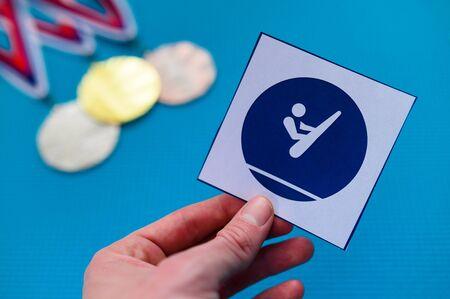 Trampoline Gymnastics icon and medal set, gold silver and bronze medal, blue background. Standard-Bild
