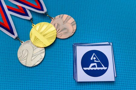 Canoe Sprint icon and medal set, gold silver and bronze medal, blue background. Original wallpaper for summer
