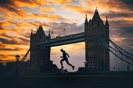 Running in London, Silhouette of runner who run near by Tower Bridge, London, United Kingdom.  Stock Photo