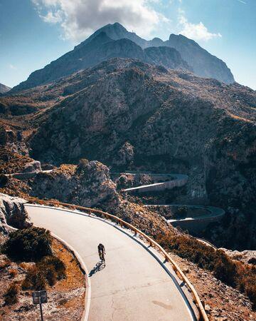Man ride on bicycle in Famous Sa Calobra Climb Mallorca Original sport wallpaper 版權商用圖片