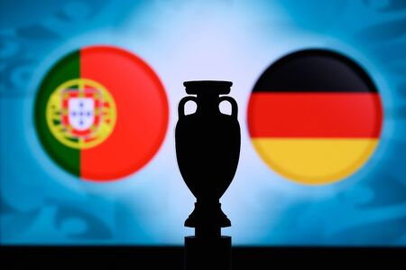Portugal vs Germany, Euro National flags, and football trophy silhouette. Background for soccer match, Group F, Munich, 20. June 2020
